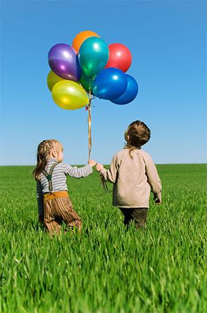 2 Kids Holding Balloons 1